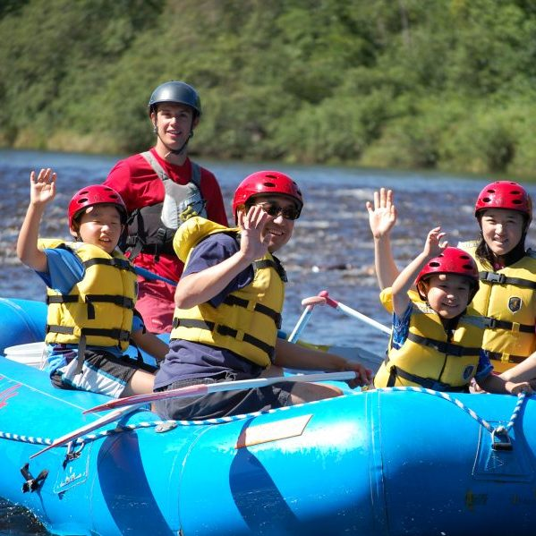Family of 4 on a river raft