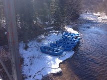 Six rafts on the frozen riverside in winter.