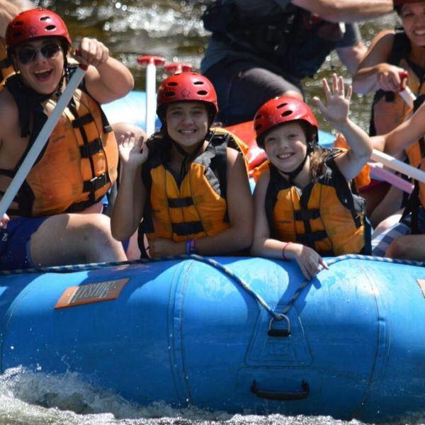 Family enjoying whitewater rafting in Maine.