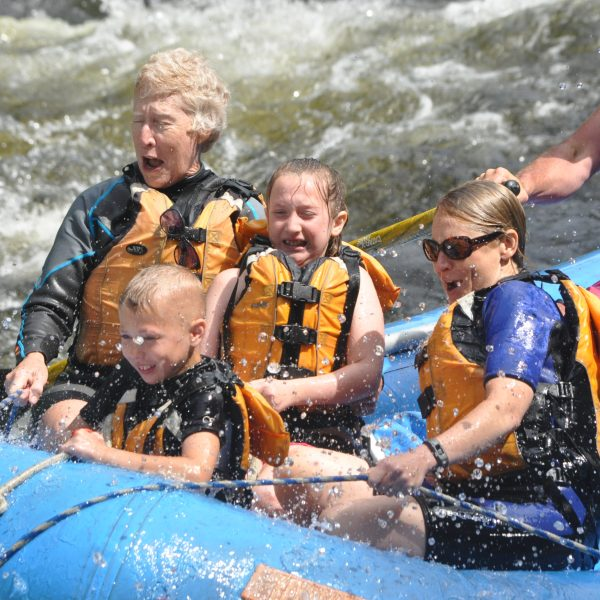Family of 4 with guide in a raft on the Kennebec River