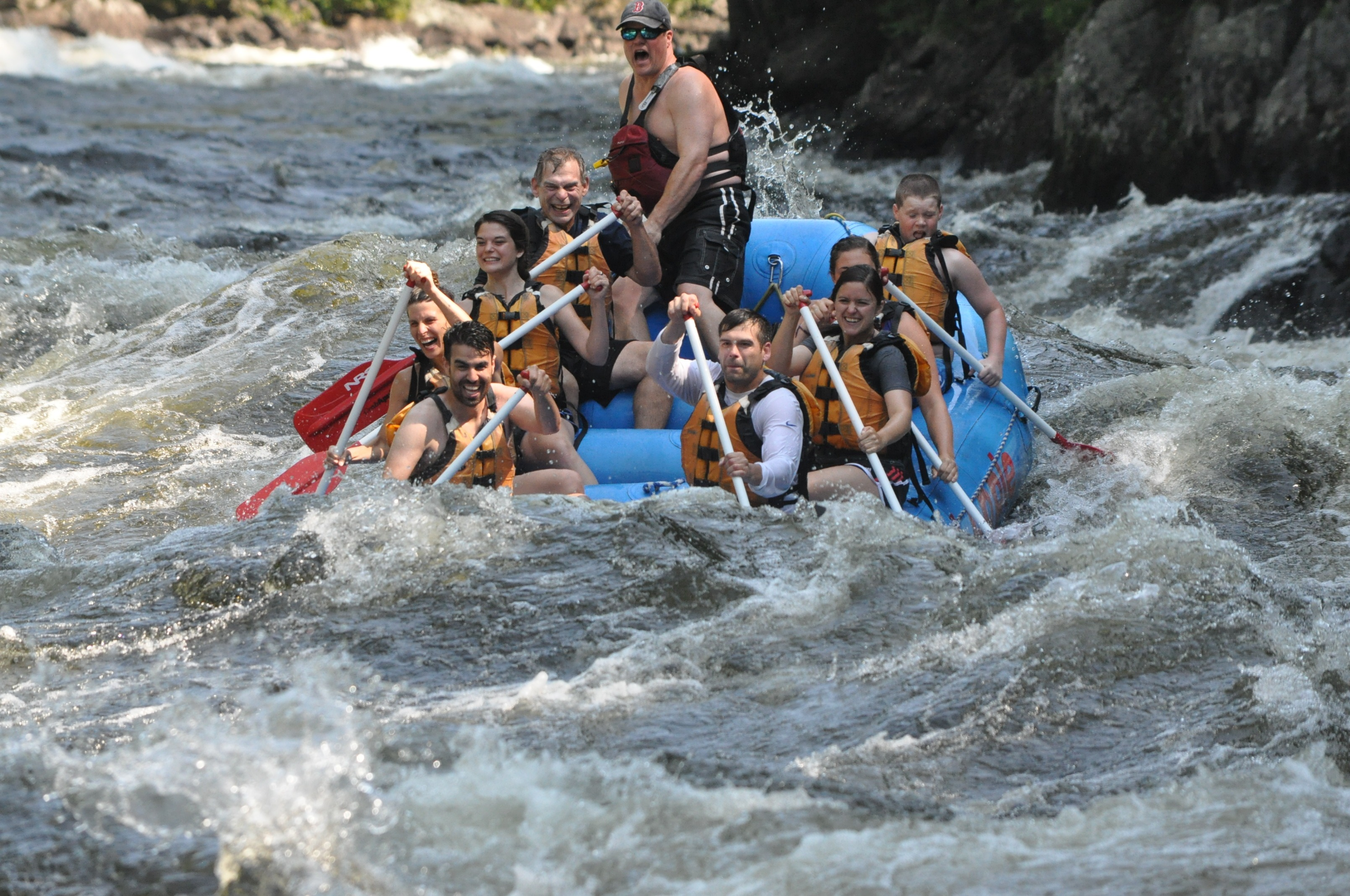 Group of eight rafts down the Kennebec River.